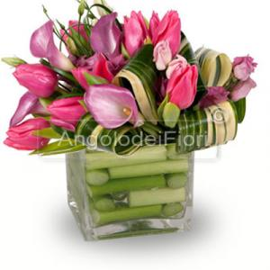 Composition in glass vase with pink flowers