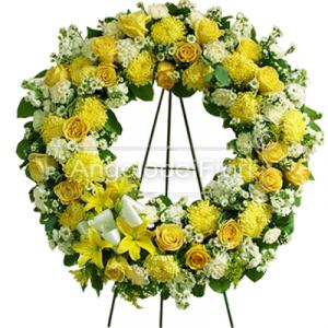 Funeral wreath with yellow and white flowers