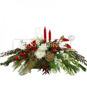 Christmas centerpiece with candles and berries